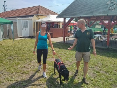 Pretty girl is traing, what is it like to trust with your closed eyes a guide dog?