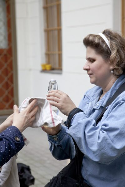 In the picture a visually impaired woman is palpating an object.